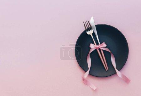 Elegant pink table setting. Top view.  Restaurant dinner or menu concept.