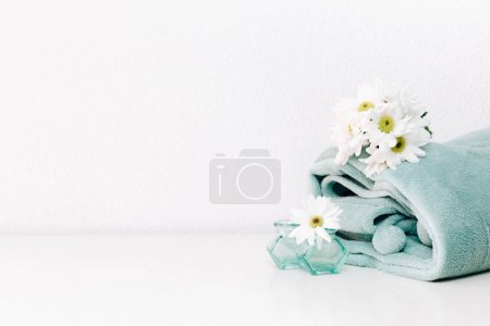 White spring flowers and blanket. Winter Spring Concept