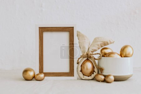 Mock Up Rustic Easter. Frame with gold eggs. Copy Space
