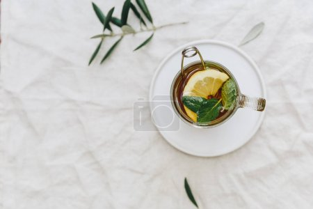 Flat lay tea with lemon and mint. Top view
