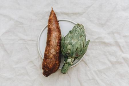 organic Artichoke,  and yucca root in the linen  rustic background