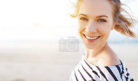 Photo for Happy young woman enjoying freedom and laughs  on se - Royalty Free Image