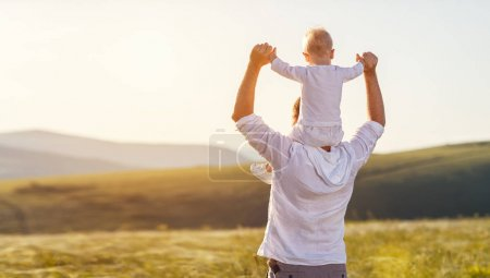 Photo for Father's day. Happy family father and toddler son playing and laughing on nature at sunset - Royalty Free Image