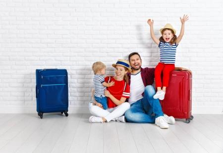 concept travel and tourism. happy family with suitcases near   w