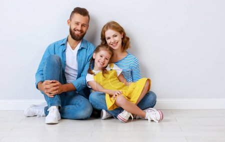 Photo for Happy family mother father and child daughter near an empty brick wall - Royalty Free Image