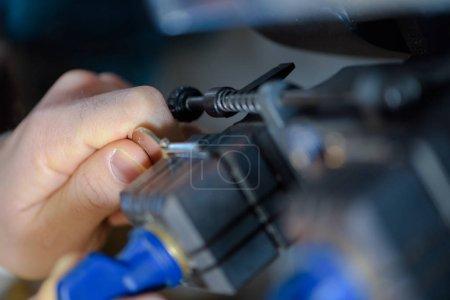 Closeup of key in machine