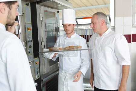 young chef to be putting food in the oven