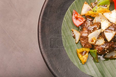 Top view of stir-fried beef with vegetable and sesame seeds