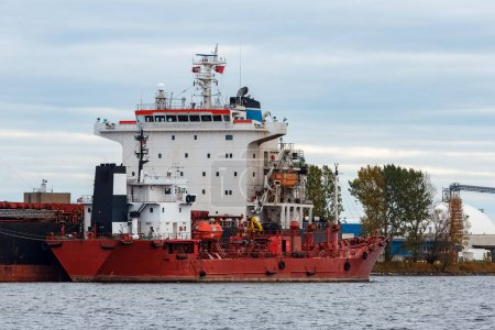 Red cargo ship loading