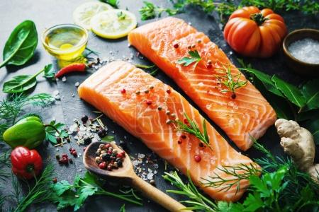 Fresh salmon fillet with aromatic herbs, spices and vegetables
