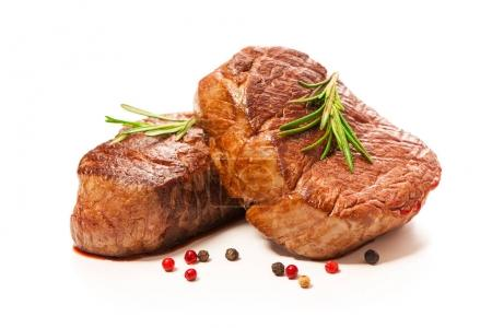 Photo for Grilled beef fillet steaks with spices isolated on white background - Royalty Free Image
