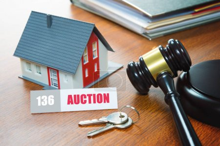 House with a Gavel. Foreclosure, real estate, sale, auction, bus