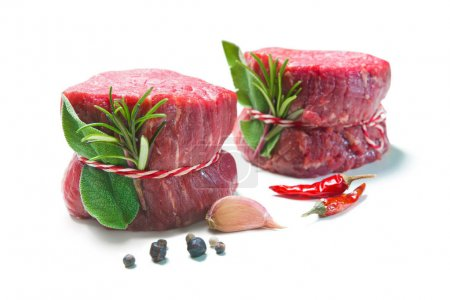 Photo for Raw beef fillet steaks mignon with spices isolated on white background - Royalty Free Image