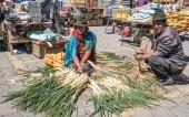 locals selling vegetables on market