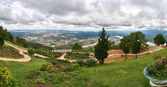 Huge Panorama from the mountain Lang Biang in Da-lat, Vietnam. Dramatic sky before the rain started.