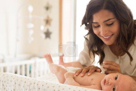 Mother moisturizing baby