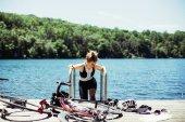 female cyclist swim in summer