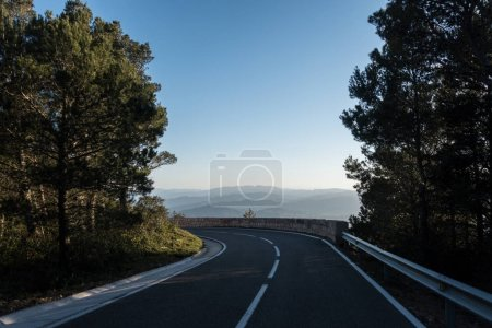 Photo for Beautiful empty narrow road in spainish mountains haze and hills - Royalty Free Image