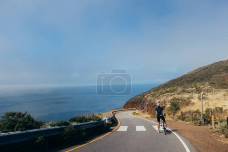 cyclist descending windy road