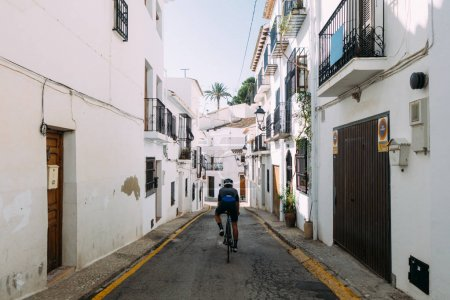 male riding through spainish streets