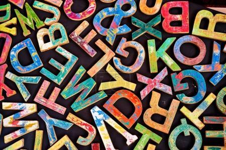 Photo pour ABC. Fond noir avec beaucoup de lettres en bois colorées - image libre de droit