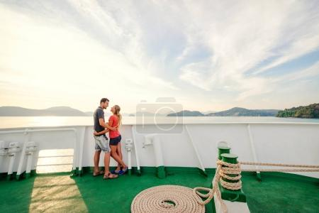 Couple enjoying sunset on cruise ship