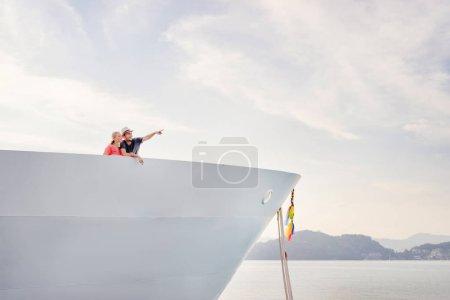 Couple enjoying view on ship