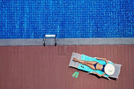 Woman in bikini on sun lounger