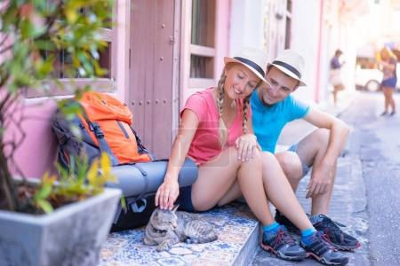 Couple of backpackers on asian street