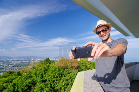 Traveler taking photo with smartphone
