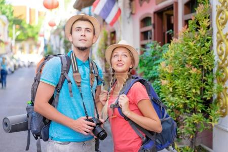 Photo for Travel and tourism. Couple of backpackers walking together on asian street - Royalty Free Image