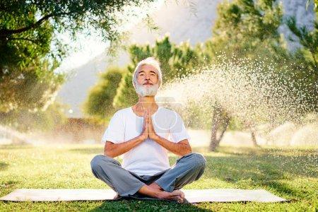 Bearded man in lotus pose