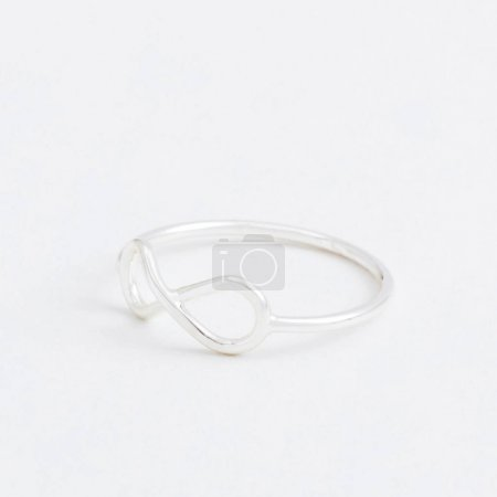 Luxury silver jewelry ring with infinity a grey background