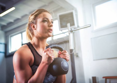 Photo for Fitness woman workout with kettlebell training at the gym - Royalty Free Image