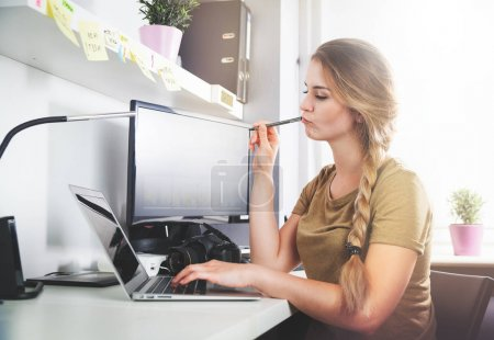 Woman working on computer at home office