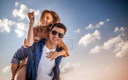 Happy couple having fun outdoor, love and friendship