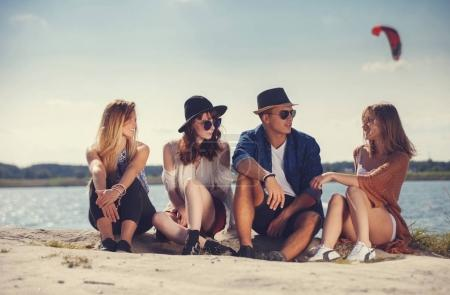 Photo for Styled group of friends at the beach having fun and enjoying summer - Royalty Free Image