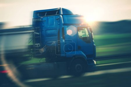 Photo for Semi Truck Euro Transportation. Speeding Semi on the Highway. Cargo and Shipping Theme. - Royalty Free Image