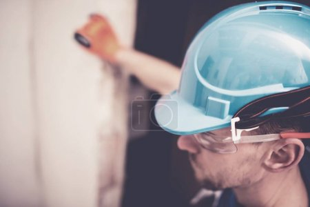 Photo for Hard Hat Construction Zone. Caucasian Worker in Blue Hard Hat Helmet. Head Safety. - Royalty Free Image