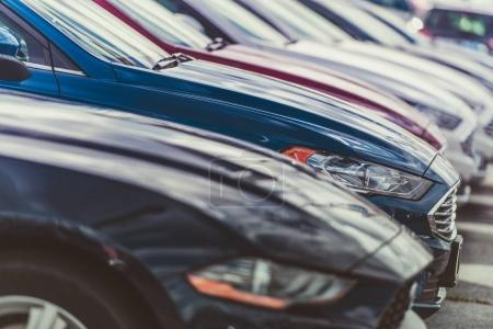 Photo for Row of New Cars on the Vehicles Dealer Lot. Transportation Industry. - Royalty Free Image