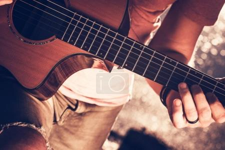 Photo for Caucasian Musician with Acoustic Guitar. Closeup Photo. Guitar Player - Royalty Free Image