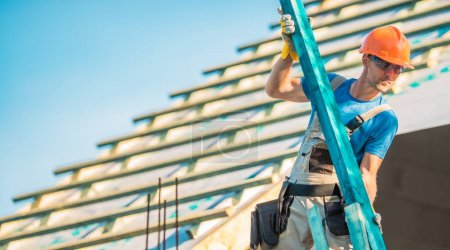 Photo for Roof Construction Wood. Caucasian Roofer with Wooden Building Structure Element. House Construction Site. - Royalty Free Image