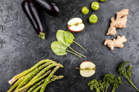 Photo for Different green fresh seasonal vegetables on black table top background - Royalty Free Image