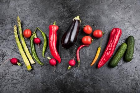 Photo for Different fresh seasonal vegetables in row on black table top background - Royalty Free Image