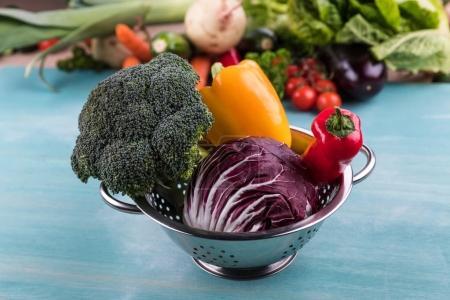 Seasonal vegetables in colander
