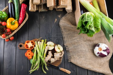 Photo for Top view of fresh vegetables on rustic wooden background - Royalty Free Image