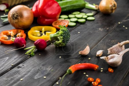 Photo for Close-up view of fresh seasonal vegetables on rustic wooden background - Royalty Free Image
