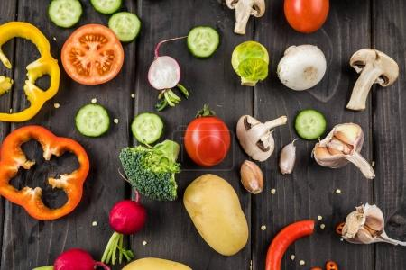 Photo for Close-up top view of fresh vegetables on rustic wooden table - Royalty Free Image