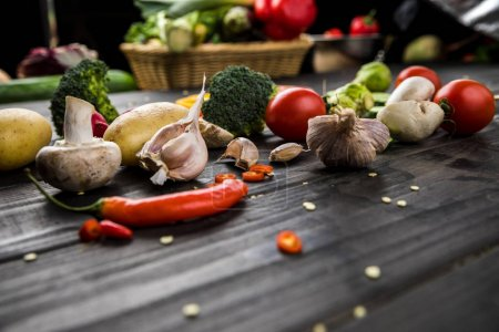Photo for Close-up view of fresh seasonal vegetables on wooden table background - Royalty Free Image