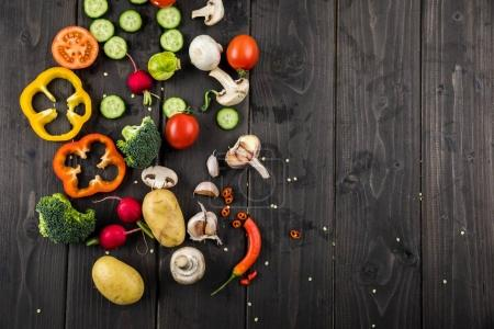Photo for Top view of fresh seasonal vegetables on rustic wooden background - Royalty Free Image